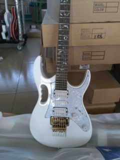 Custom Ibans electric guitar in snow white with vine fretboard inlays 21 to 24 frets deep scalloped guitar gold hardware